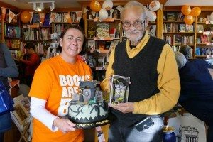 Alan Bradley with his book and matching birthday cake