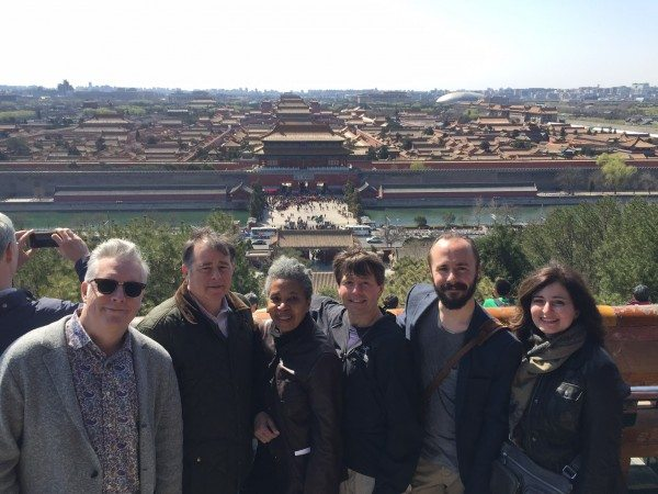 Ricky Mugford, Geoffrey Taylor, Dionne Brand, Michael Crummey, Andy McGuire, and Christine Saratsiotis look over The Forbidden City from a temple at Jingshan Park.